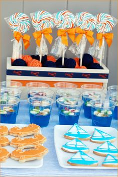 "Two less Fish theme for Taylor's shower     Make the 'blue fin"" martini from New York  Make a ""The In-law"" glass for jeanice with a blue boa and ""The bride"" martini glass for tays fake-tini    Gummy fish in Jello is very cute at this Preppy Beach Party"