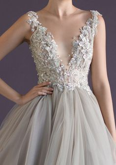 Dove-gray tulle and a sparkling bodice covered in crystals and floral appliqués