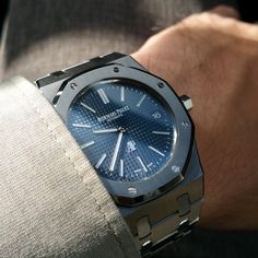 """Audemars Piguet Royal Oak Extra Thin WatchDescription:Selfwinding watch with date display. Stainless steel case, blue dial, stainless steel bracelet.Case: Stainless steel case, glareproofed sapphire crystal and casebackCase Width: 39.00 mmWater Resistance: 50 mCase Thickness: 8.10 mmDial: Blue dial with """"Petite Tapisserie"""" pattern, white gold applied hour-markers and Royal Oak hands with luminescent coatingBracelet: Stainless steel bracelet with AP folding claspCalibre: Selfwinding…"""
