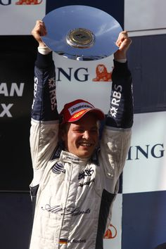 Nico Rosberg lifts his 3rd place trophy to the sky, at the 2008 Australian GP