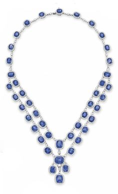 A SAPPHIRE AND DIAMOND NECKLACE. Designed as a two-row swag of cushion-cut sapphires, each within a circular-cut diamond surround, spaced by collet-set diamonds, mounted in platinum, 16¾ ins. With report CS 57398 dated 22 October 2013 from the American Gemological Laboratories stating that the sapphires would be classifed as Burma (Myanmar). No gemological evidence of heat (an excess of 50 tested at random)