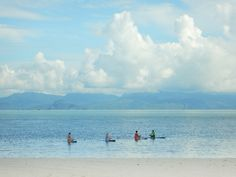 The seas around Langkawi are shallow. Small, uninhabited islands are common, but reefs below the surface are not. Scuba divers head north to Thailand, but activities like surfboard yoga (pictured), stand-up paddleboarding, sailing, Jet Skiing, kayaking, hiking, mountain biking, birding, and rock climbing are all popular Langkawi activities, alongside the unofficial national sport of eating.