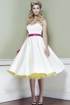 Just the right length petticoat, lovely retro dress and hair too, with no raccoon eye make-up or bloated lips. Delightful to see feminine embracing femininity.