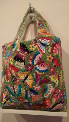 Bright embroidered purse probably from Guatemala.Sublime Stitching Tutorials and Stitch Diagrams by Jenny Hart Embroidery Bags, Embroidery Stitches, Embroidery Patterns, Boho Bags, Handmade Purses, Patchwork Bags, Fabric Bags, Sewing Crafts, Needlework
