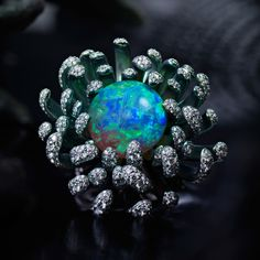 Chopard Fleurs d'Opales ring diamond and rhodium petals Find out more A 14ct white opal is the centrepiece in this Fleurs d'Opales ring by Chopard, crafted from rhodiumed white gold and titanium