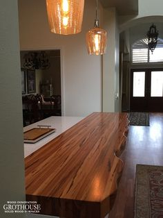 Tigerwood Faux Live Edge Countertop with a Faux Live Edge profile and a Durata® Waterproof Permanent Finish in Satin Sheen. Designed by S & W Kitchens Inc. https://www.glumber.com/image-library/tigerwood-countertop-with-faux-live-edge-in-florida/