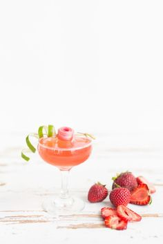 Strawberry Rhubarb Daiquiri cocktails, perfect for spring! Be sure to pin for later and get the full recipe on Jojotastic.com