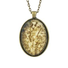 One-of-a-kind pendant created by artist Cassandra Tondro from an original leaf print. Each pendant is an intriguing fossil-like design in gorgeous Earth tone colors.