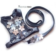 Dog Harness Springtime in Black Shimmery black garment weight leather lined in black satin. Adorned with metallic leather flowers in two sizes and 5 colors, silver, gold, blue and copper, with rhinestone grommet centers. You can add a fancy matching leash here: