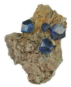 Boleite, 	KPb26Ag9Cu24Cl62(OH)48, Amelia Mine, Santa Rosalía, Boleo District, Mun. de Mulegé, Baja California Sur, Mexico. Dimensions: 5 x 4 x 2.3 cm. The rarest habit of boleite is this modified, complex style...and these are superb examples, which reach 1 cm and are all razor sharp. Copyright: © Rob Lavinsky