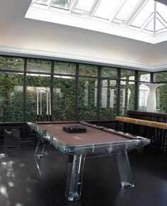 FILOTTO pool table surrounded by the colours of the nature. Light on crystal fits perfectly!  #poolTable #billiard #snooker #design #luxury #furniture #gameTable #interiors #manCave #crystal #tailoring #madeInItaly