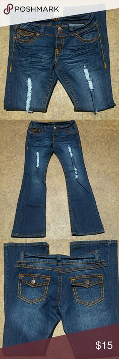 """Distressed Bootcut Denim Jeans Distressed denim bootcut jeans.  Brand: V.I.P. Size: 11/12. 66% Ramie, 42% Cotton, 2% Spandex. Soft material. Slight signs of wear. When laying flat, waist: approximately 32"""", inseam: 31"""", rise: 8"""", flare: 9"""". Comes from a smoke free home. Final price unless bundled. No trades, no holds, thank you. V.I.P. Jeans Boot Cut"""