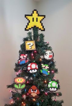 Make your home a happy home for the holidays with this Super Mario Bros. Star Tree Topper has a STRONG support hot glued in the back. *Made with Perler Beads and Love :) **Need Stocking Stuffers?** **check out my lighter cases! Diy Xmas, Diy Christmas Tree Topper, Unique Christmas Trees, Noel Christmas, Christmas Ornaments, Funny Christmas, Holiday Tree, Star Tree Topper, Original Mario Bros