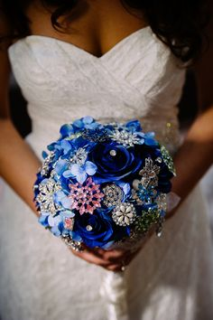 Deep blue fresh flower/brooch combo wedding bouquet. Photography by Mike L Photo.