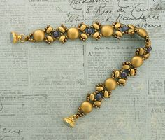 Linda's Crafty Inspirations: Bracelet of the Day: Lucy - Gold & Purple