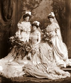 1904 wedding picture. Bride and bridesmaids. But it looks more like a collection of ladies in court gowns