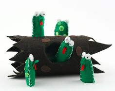"Five speckled frogs can be used for all pre-school songs involving frogs. Measuring approximately 3"" x 1&1/2,"" these five frog finger puppets are stored in a speckled log."