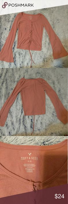 Shirt Darling lace up pink shirt. Very soft and comfortable. Worn once, just not my style. Let me know if you have any questions! American Eagle Outfitters Tops Blouses