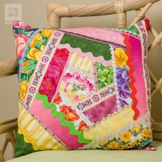 Decorate your home with this jazzy quilted pillow– a great pattern for the experienced quilter!