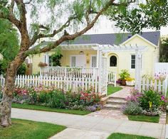Yellow Houses Cute yellow and white cottage with white picket fence. This looks like a perfect house to me. :-)Cute yellow and white cottage with white picket fence. This looks like a perfect house to me. Landscape Design, Garden Design, Terrace Design, Contemporary Landscape, House Design, Staircase Contemporary, Landscape Bricks, Contemporary Building, Contemporary Cottage