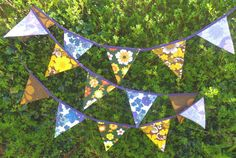 Funky retro boho handmade double sided bunting. vintage fabrics 1960s 1970s . bright floral. purple yellow blue orange brown approx 4 metres...