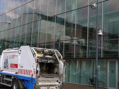 https://flic.kr/p/FXRu6f | 2016.04 - Amsterdam photo of reflections & garbage truck in front of reflecting glass-wall on Oosterburgereiland; geotagged free urban picture, in public domain / Commons; Dutch photography, Fons Heijnsbroek, The Netherlands | Amsterdam photo of glass-wall reflections and a passing garbage truck, in front of the large glass-walls and buildings on Oosterburgereiland - location Oostenburg district in Amsterdam city.  Urban photography of urban reflections in the…