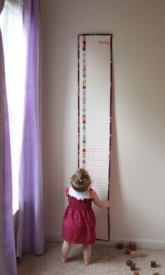 "Fabric growth chart.  Made of 6 - 12"" blocks, quilted at 1"" intervals."