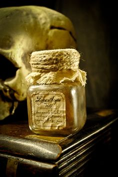 Lycanthrope Hair Sample in a Specimen Jar - I like the idea of using fabric, wax and string to seal a specimen jar, particularly those that are missing the lid.
