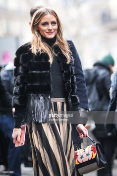 Olivia Palermo wears a black fur coat, outside the Elie Saab show, during Paris Fashion Week Haute Couture Spring Summer 2017, on January 25, 2017 in Paris, France.