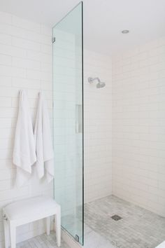 Fabulous bathroom features shower with glass partition accented with Daltile Arctic White Tile surround as well as carrera marble subway tiled shower floor. Subway Tile Showers, Subway Tiles, White Subway Tile Shower, White Shower, White Tiles, Wall Tiles, Bathroom Renos, Laundry In Bathroom, Bad Inspiration