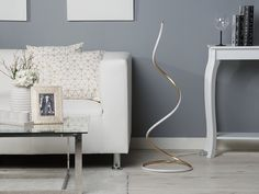 Modern floor lamp, a decorative piece that blends perfectly with any modern, minimalist or Scandinavian interior. Rattan Furniture, Beliani, Wicker Patio Furniture, Lamp, Gold Floor Lamp, Home And Living, Furniture, Modern Floor Lamps, Scandinavian Interior