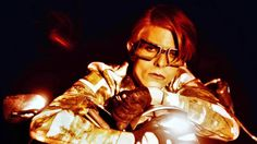 David Bowie draped upon a motorbike, Los Angeles 1975, by Steve Schapiro