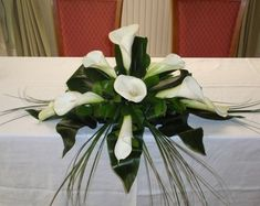 white calla lily sweetheart or head table reception wedding flowers,  wedding decor, wedding flower centerpiece, wedding flower arrangement, add pic source on comment and we will update it. www.myfloweraffair.com can create this beautiful wedding flower look.