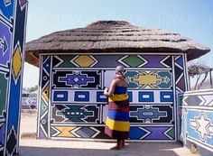 Ndebele woman painting her house. 40 Simple and Easy Landscape Painting IdeasAbstract Art, Cloud Painting Print , Cloud Print ,…Striking Abstract Portraits that Eerily Express…Original Oil Painting Modern Large Wall Art Decor… African Hut, African Tribes, African Style, Woman Painting, House Painting, Easy Landscape Paintings, Mud Hut, Geometric Painting, African Artists