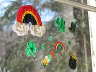 Make some St. Patrick's Day Window Clings - rainbows, shamrocks, leprechaun hats, and a pot of gold!