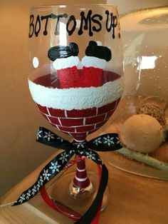 Bottoms up Santa 20 oz wine glass. Heat set although recommend hand wash. Bottoms up Santa 20 oz wine glass. Heat set although recommend hand wash. Wine Glass Crafts, Wine Craft, Wine Bottle Crafts, Bottle Art, Homemade Christmas Gifts, Christmas Diy, Christmas Decorations, Christmas Bulbs, Christmas Crafts For Adults