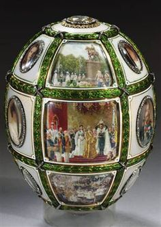 Fabergé: 15th Anniversary Egg 1911. The grid-shaped cage work of gold/ green enamel garlands frames 18 scenes painted by court miniaturist V. Zuiev. Some of the events of Tsar Nicholas II/ Tsarina Alexandra's reign over the past 15 yrs are recorded in the historical vignettes. Individual portraits of the Tsarina, her husband & their 5 children are set w/in oval-shaped apertures bordered by diamonds
