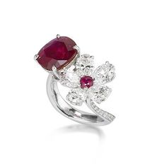 A fine 4.02 carats cushion-shaped 'Pigeon's Blood' Burma ruby and diamond dress ring.