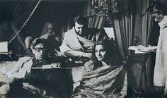 Ray on the set of The Home and the World (1984) with actors Soumitra Chatterjee and Swatilekha Chattopadhyay