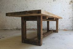 Reclaimed barn wood was used to craft this table. The wood in question is oak.