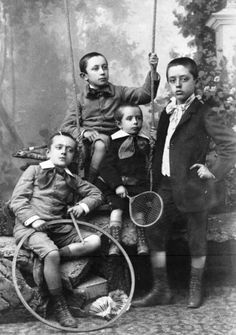 A quartet of dapperly attired young Victorian gents.