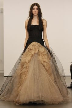Vera Wang - Black corset + nude ruffled, tulle skirt. There's a unique wedding gown, folks.