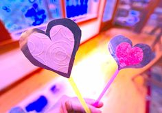 Pie tins and plastic straws make the cutest heart wands for Valentines Day.
