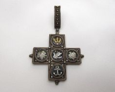 Victorian Micro Mosaic Cross Circa 1860.  Each image on the cross represents an as aspect of the Christian faith. The wheat and grapes represent the Sacrements and the Holy Communion. The Dove represents Peace  and the Holy Spirit. The anchor represents Hope.