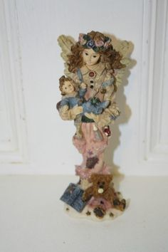 """Boyd's 'Serenity...the mother' Angel' figurine measures approx  ; 6 3/4"""" x 2.5"""" x 2"""" ed/pc# 28E/2911 style #28204 from 1996 Folkstone collection 'God could not be everywhere and therefor made mothers' $10"""