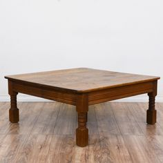 This rustic coffee table is featured in a solid wood with a distressed light cherry finish. This large coffee table is in good condition with carved block feet, fluted trim and a square table top. Great for holding books and magazines! #rustic #tables #coffeetable #sandiegovintage #vintagefurniture