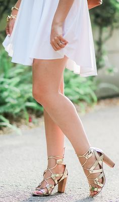 Every woman needs to own these shoes. Seriously, @bananarepublic knocked it out of the park with these gorgeous gold lace-up heels. They're beautiful, but they're also extremely comfortable. I've worn them for 12 hours straight without blisters! Click through this pin to see how I styled these heels w/ an @expresslife white button-down dress + learn how I got amazing new hair for the season thanks to my friends at @haircuttery!   by Ashley Brooke Nicholas #MyHCLook sponsored by Hair Cuttery