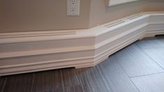 This is a sleek custom wood baseboard heater cover with an elegant rounded top. I covered the face of the cover with the same baseboard moulding that is already in the home, so the cover almost disappears when seen from across the room. Baseboard Radiator, Baseboard Heater Covers, Wood Baseboard, Modern Baseboards, Baseboard Heating, Basement Renovations, Home Renovation, Modern Radiator Cover, Narrow Hallway Decorating