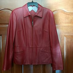 Stunning RED LEATHER Jacket Genuine Lamb Skin. Fully lined. Front zipper with 2 front slit pockets. I had to look hard to find any wear spots,  see 3rd photo. Actually color is like the 1st photo.  Super cute and we'll cared for. Preston & York Jackets & Coats