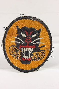 "Uniform worn, WWII, Tank Destroyer patch featuring ferocious panther and 8-wheels designation. 2 7/8"" long x 2 3/8"" wide. When tested under a black light, it did not glow as modern made reproductions"